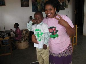 Divinity with her son Shafiq in Uganda